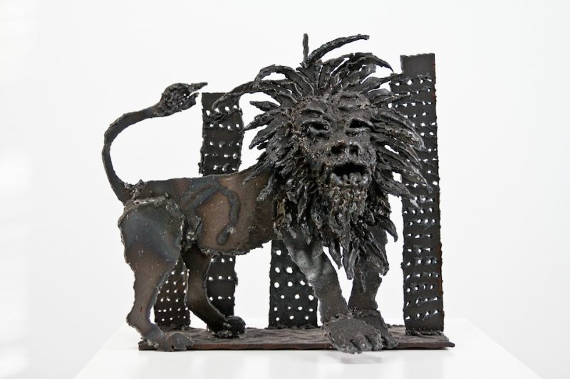 Lion in the concrete jungle metal sculpture