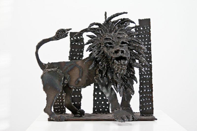 Lion in the concrete jungle metal sculpture