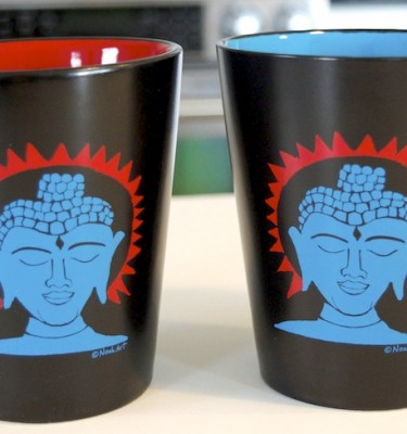 Set of 2 Buddha mugs created from a block print by Noah Baumwoll. Start your morning with a reminder to be mindful.
